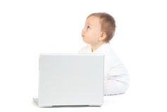 Baby sat with laptop computer Stock Image