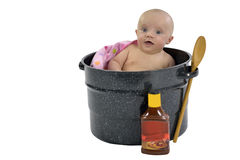 Baby in saucepan Stock Photography