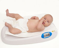 Baby on scale, isolated Stock Photo