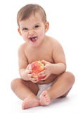 Baby with scared face keeping an apple. Royalty Free Stock Photos