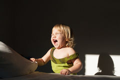 Baby screaming sunlight Stock Photography