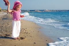 A baby and the sea. A baby discovering the sea royalty free stock photos