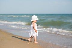 Baby on the sea beach Stock Photos