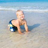 Baby in a sea Stock Photo