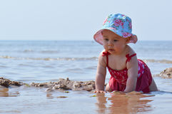 Baby in sea water Stock Photos