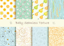 Baby seamless texture. Set of baby seamless texture in light orange and blue colors. Eight beautiful seamless textures with cats, suns, pears, bees, feathers Royalty Free Stock Image