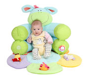 Baby in a seat Stock Photos