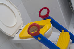 Baby seat for toilet. Baby plastic seat with a step toilet royalty free stock images