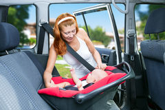 Baby seats in the car seat Stock Image
