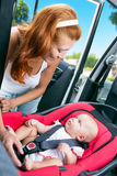 Baby seats in the car seat Royalty Free Stock Photo