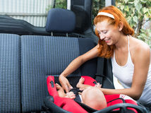 Baby seats in the car seat Royalty Free Stock Image