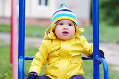 Baby on seesaw Royalty Free Stock Photography
