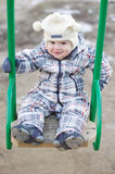 Baby on seesaw outdoors Royalty Free Stock Photo