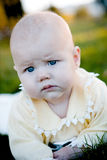 Baby serious. Portret of a serious child with blue eyes stock photo