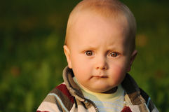 Baby with serious expression Royalty Free Stock Image
