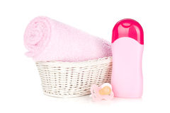 Baby shampoo, pacifier and towel for girl Stock Photo