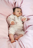Baby in sheets Stock Photo