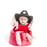 Baby in sheriffs hat Stock Photo
