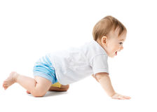 Baby in a shirt crawling and laughing Stock Image