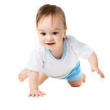 Baby in a shirt crawling and laughing Royalty Free Stock Images
