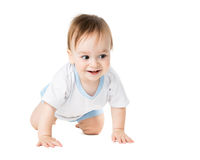 Baby in a shirt crawling and laughing Stock Photo