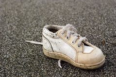 Baby Shoe on Beach. Baby shoe found on a Beach in Northern California. Close-up Macro photography Stock Photos