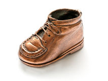 Baby shoe in bronze Royalty Free Stock Photos