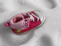 Baby shoe on snow Stock Images