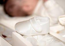 Baby shoe. White shoe for newborn babies Stock Photo