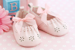 Baby shoes. Pink baby shoes for a baby girl royalty free stock photography