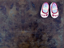 Baby shoes. Pink baby shoes on vintage background Royalty Free Stock Photography