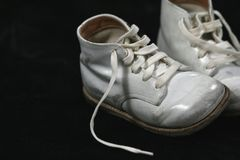 Baby Shoes. A pair of baby shoes on a black background royalty free stock images