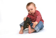 Baby and shoes Stock Image