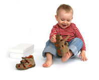 Baby and shoes Royalty Free Stock Image