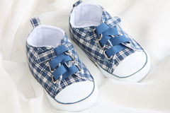Baby Shoes. Small baby shoes on soft silk Stock Images