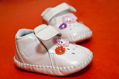 Baby shoes. With colored flowers royalty free stock photography