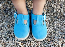 Baby Shoes. Children's feet in blue shoes Stock Photos
