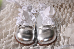 Baby shoes. Silver baby shoes with socks Royalty Free Stock Photography