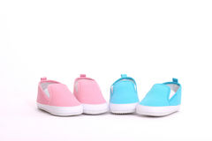 Baby shoes. Shoes for a boy and a girl stock photo