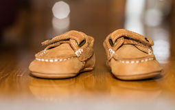 Baby shoes. Brown baby shoes ready for use royalty free stock image