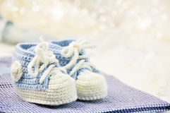 Baby shoes. With bokeh background royalty free stock photos