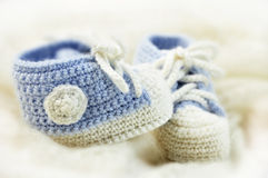 Baby shoes. With bokeh background Royalty Free Stock Images
