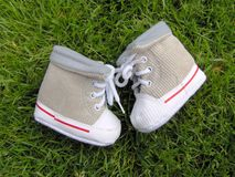 Baby shoes. Cute ribcord baby shoes in the garden Royalty Free Stock Photo
