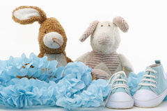 Baby shoes. Blue shoes and two old teddies royalty free stock photography