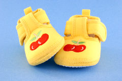 Baby shoes. Yellow baby shoes Stock Image