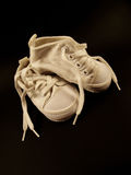 Baby shoes. On dark background Stock Photography