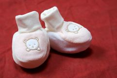 Baby shoes. On red background royalty free stock photography