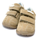 Baby Shoes. Beige baby shoes on white backgroud Royalty Free Stock Images
