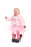 Baby in the shoes of adults, and a pink tutu Stock Images