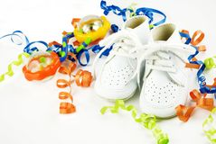 Baby Shoes Baby Rattle Curly Ribbons Stock Photo